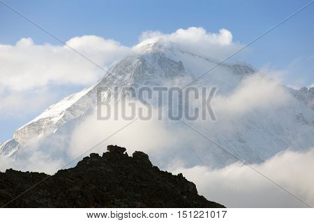 view of mount cho oyu in the middle of clouds Everest area Sagarmatha national park nepal
