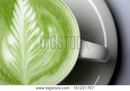 drink, diet, weight-loss and slimming concept - close up of matcha green tea latte in cup