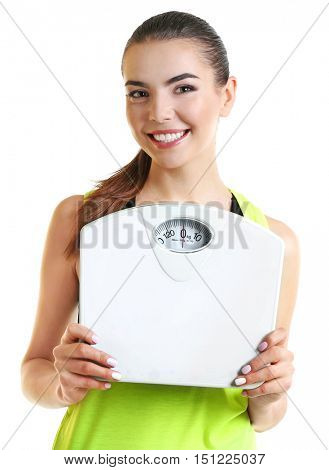 Young beautiful woman with scales on white background.