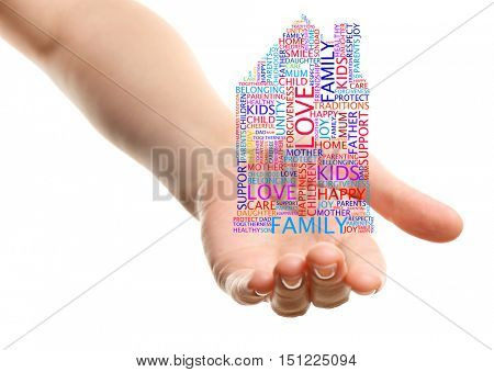 Female hand holding house shaped word cloud on white background. Family concept.
