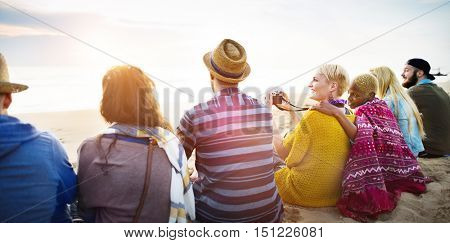 Group Of People Sitting On the Beach Concept