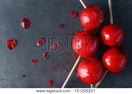 Toffee apples on grey background