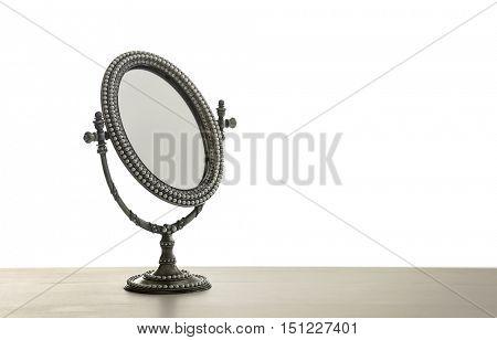 Female mirror on light background