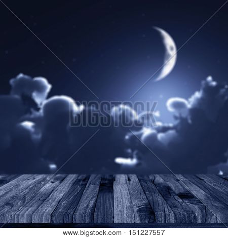 3D render of a Halloween background with a wooden decking against a defocussed night sky