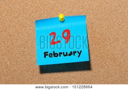 February 29th. Calendar for februar 29 on cork notice board background. empty space. Leap year, intercalary day.
