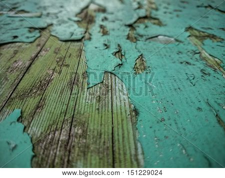 Wood background with old green peeling paint, horizontal view