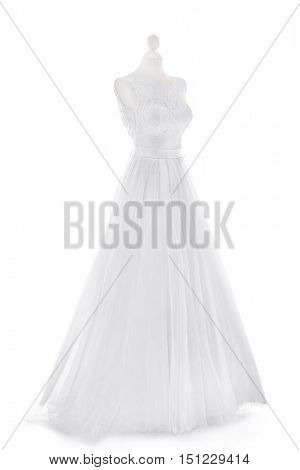 Made-up wedding dress on mannequin against white background