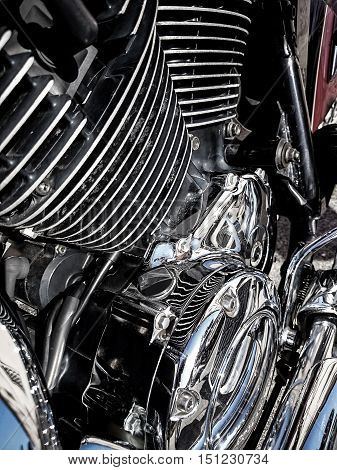 Motorcycle engine close-up as background, top view