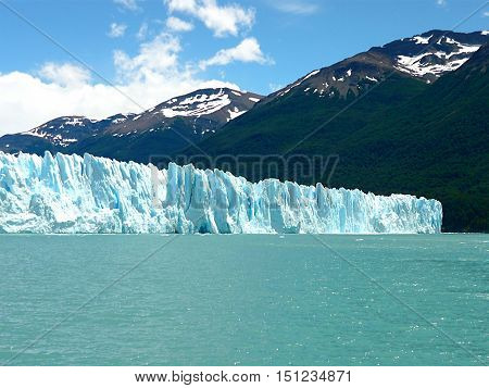 Ice wall.  The beauty of a wall of ice. Perito Moreno Glacier emerges on the water for about 60 meters and has 5 km front. It is one of the most beautiful places in Patagonia. Argentina