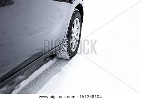 Car's Winter tyres in extreme cold temperature, trail on snow, white copy space
