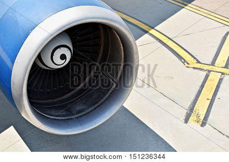 Big airplane propeller engine detail on the runway