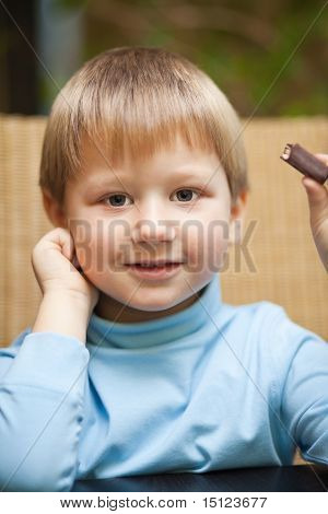 Little Boy With Chocolate Candy