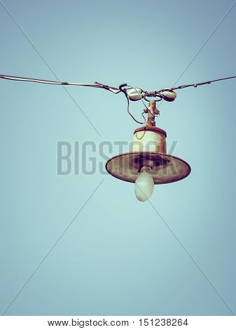 Color filter image/ Old bulb hanging on the sky, Selective focus