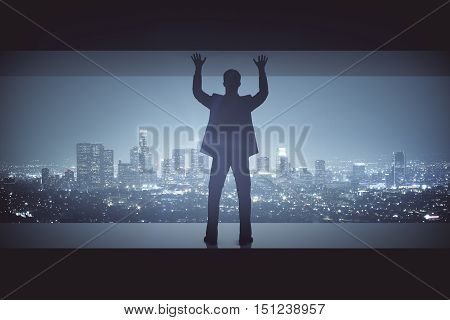 Struggling man between concrete walls on illuminated night city background. Pressure concept