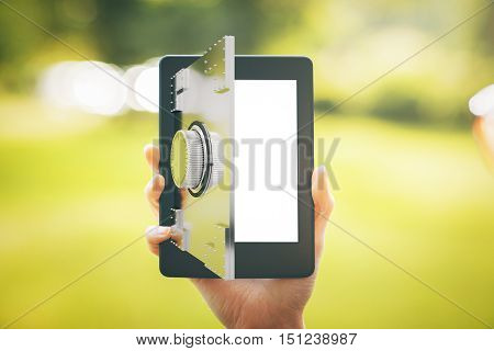 Close up of female hand holding digital tablet with abstract open bank vault door on blurry landscape background. Online banking concept. 3D Rendering