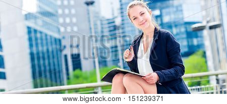 Dynamic Young Executive Taking Notes On Her Agenda
