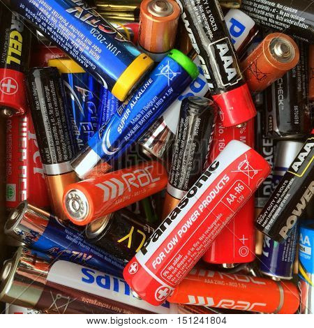 London, England - October 11, 2016: Random collection of batteries of various sizes and brands ready for use or disposal
