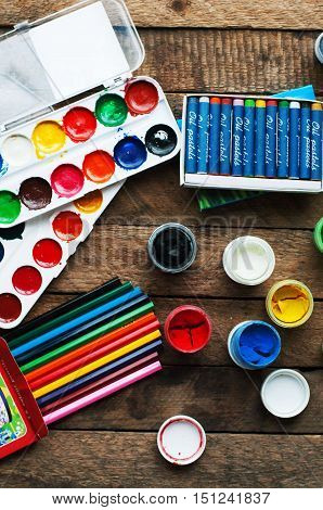 Art Of Painting. Paint Buckets On Wood Background. Different Pai