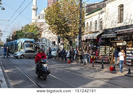 Street Photo of Istanbul City with Tram Motor Bike Cars and Crowd walking. Istanbul, Turkey, November 19th, 2015