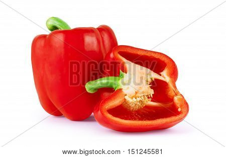 fresh red bell pepper (capsicum) and a cut one on a white background