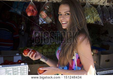 Caucasian female shopping in an African market