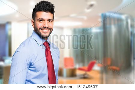 Young businessman in his office with copy-space.