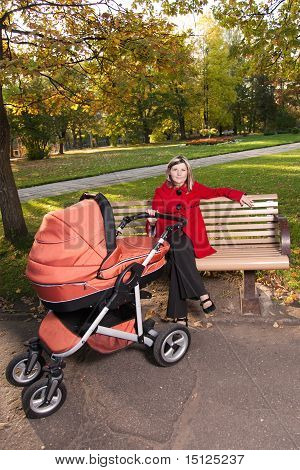 Young Woman On Bench With A Pram.