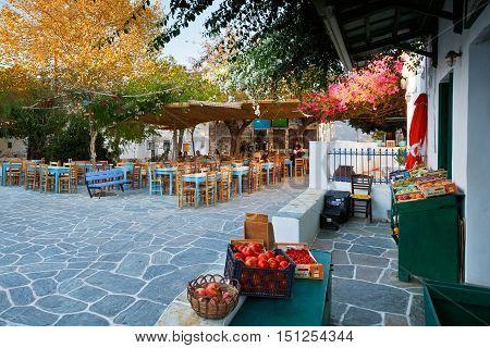 FOLEGANDROS, GREECE - SEPTEMBER 24, 2016: Restaurants and a shop in the main square of Folegandros village on September 24.