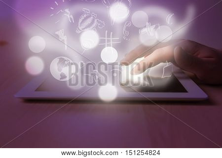 The white tablet with a blank screen and the hand on table. the concept of empowerment