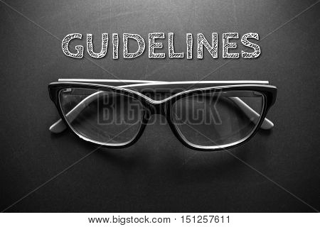 GUIDELINES, message on the Black with eyeglasses, black and white tone / business concept