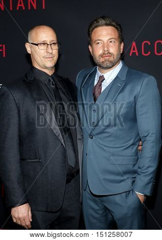 Ben Affleck and Gavin O'Connor at the Los Angeles premiere of 'The Accountant' held at the TCL Chinese Theater in Hollywood, USA on October 10, 2016.