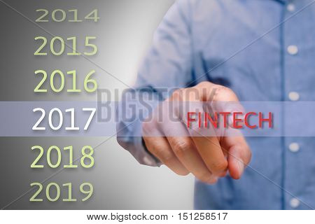 bussinessman hand pointing fintech text for 2017. targets concept
