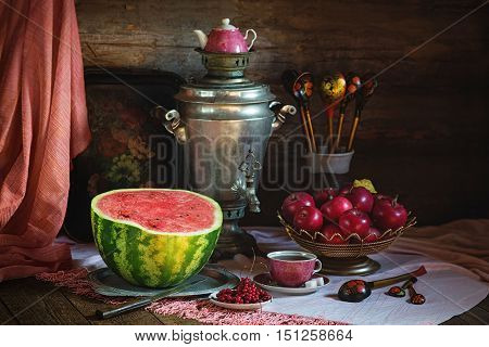 Rural still life with red color subjectsand and samovar