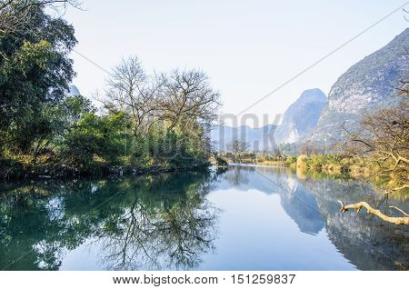 The karst mountains and rural scenery background in winter