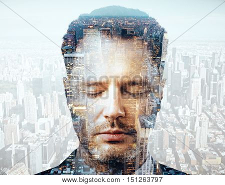 Close up portrait of handsome young businessman on city background. Double exposure. Brainstorming concept