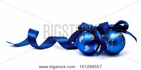 Two perfect blue christmas balls with ribbon isolated on a white background