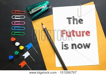 Text The future is now on white paper background / business concept