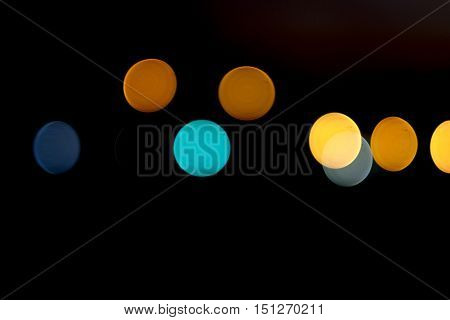 Bokeh effect at night with colorful circles patterns