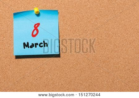 March 8th. Day 8 of month, calendar on cork notice board background. Spring time, empty space for text.
