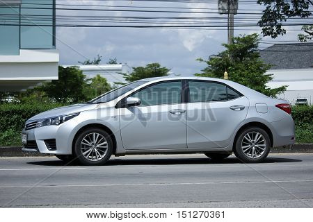 CHIANGMAI THAILAND - OCTOBER 2 2016: Private car Toyota Corolla Altis. On road no.1001 North of city about 8 km from Chiangmai Center.