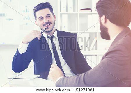 Attractive Businessmen Discussing Stuff
