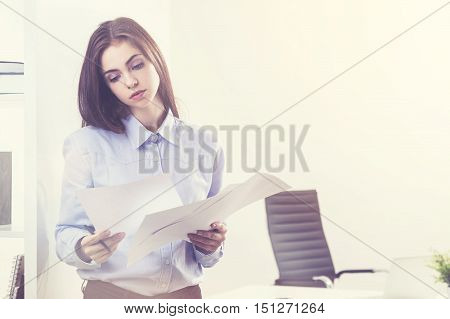 Woman Doing Paperwork In Office