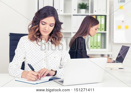 Two Secretaries Working In Office