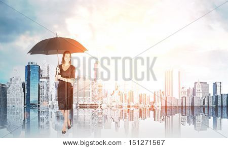 Woman wearing dress with black umbrella is standing in sunlit city and smiling. Concept of delusion and not paying attention to environment. Toned image