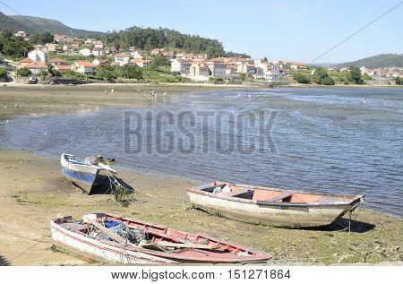 COMBARRO, SPAIN - AUGUST 10, 2016: People at the shore of the ria in Combarro a village of the province of Pontevedra in the Galicia region of Spain.