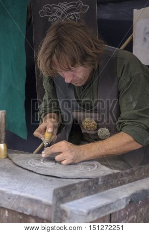 Avila, Spain - September 03, 2016 exhibition of stonemason in a medieval market