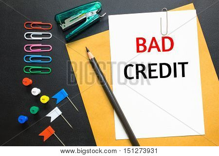 Text Bad credit on white paper background / business concept