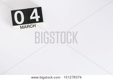 March 3rd. Day 3 of month, wooden color calendar on white background. Spring time, empty space for text.
