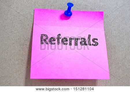 Text Referrals on pink paper note / business concept