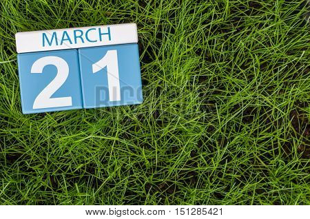 March 21st. Day 21 of month, calendar on football green grass background. Spring time, empty space for text.